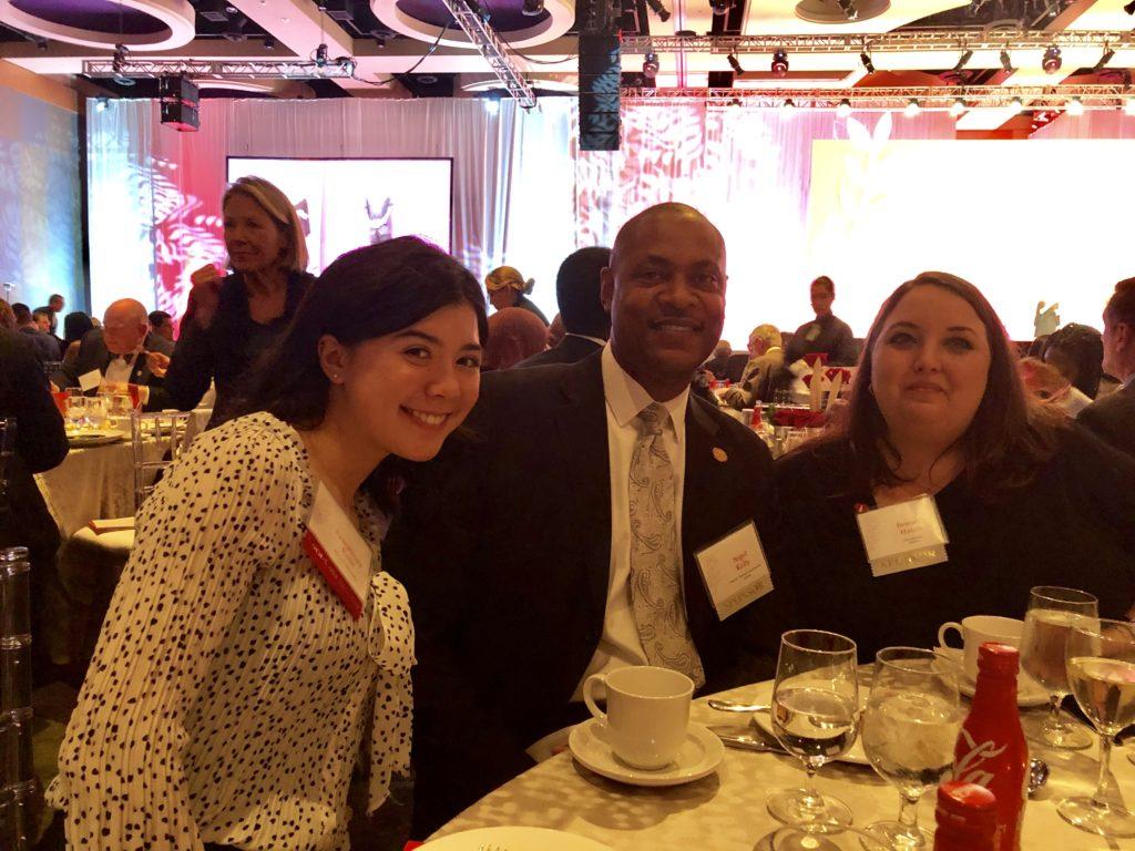 Coca-Cola Scholarship winner with Team Atlanta at dinner table