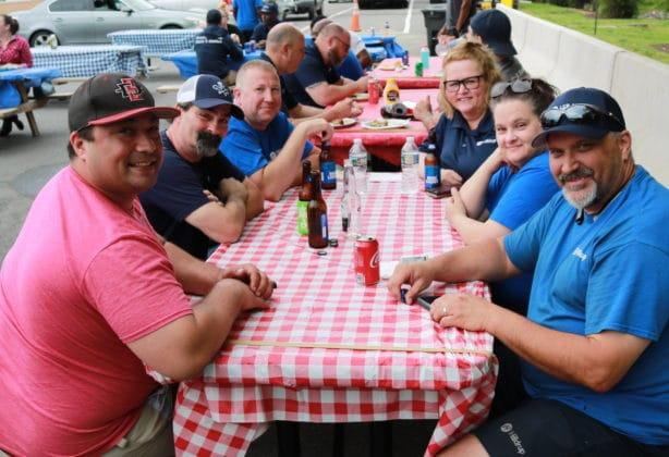 Hilldrup employees enjoy a BBQ outdoors