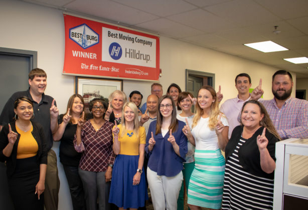 "Hilldrup employees raise a ""#1"" in support of Hilldrup being named the Best Moving Company in the Fredericksburg area."