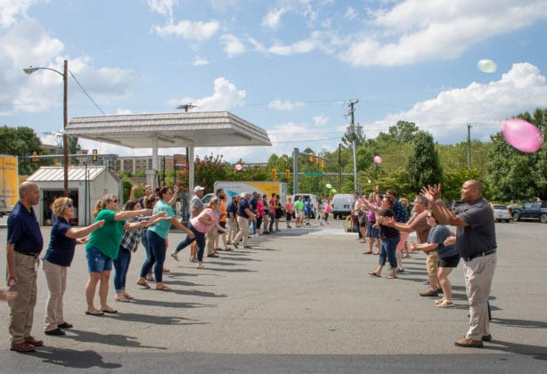 Hilldrup employees participating in a waterballoon toss.