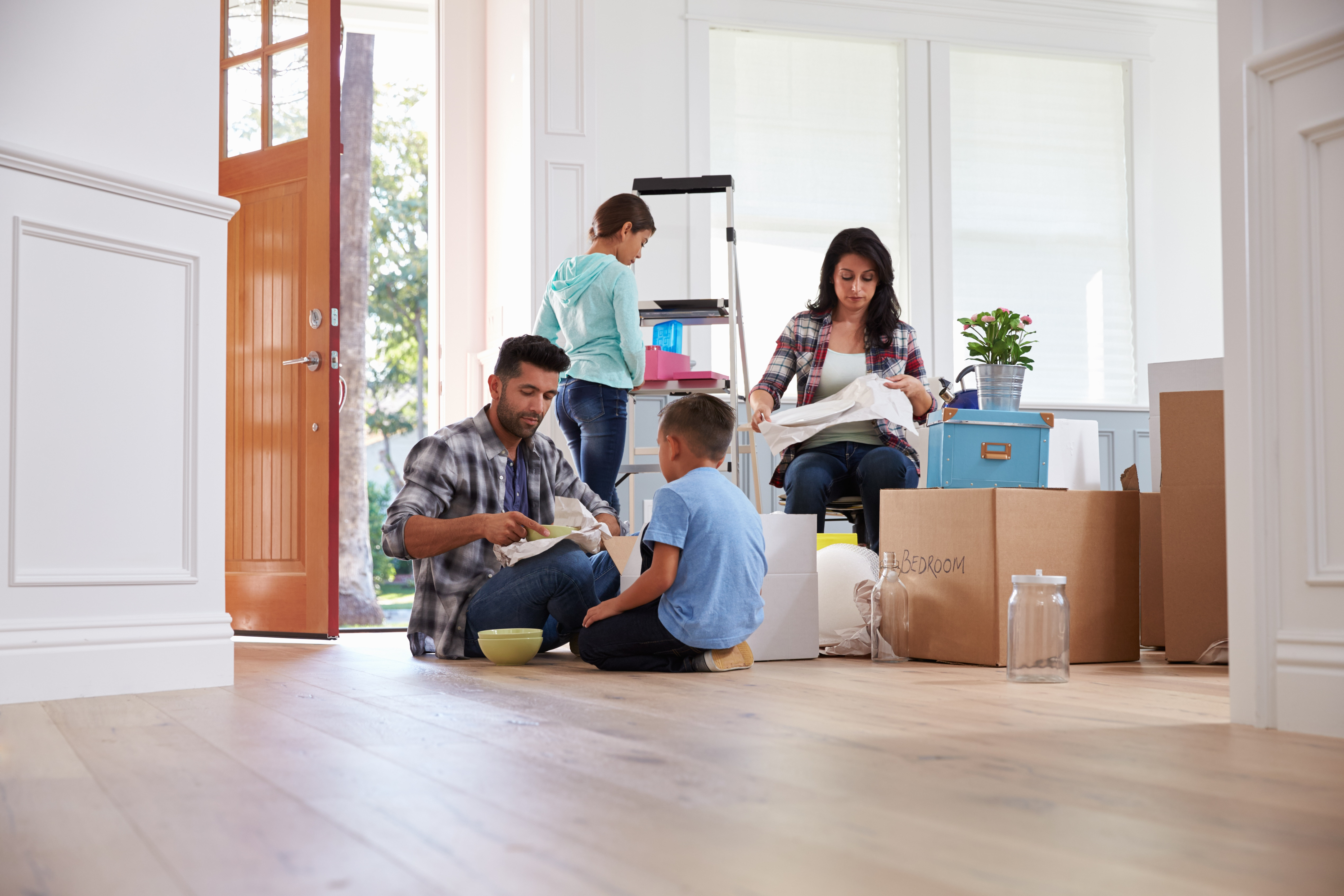 A family unpacking within a home