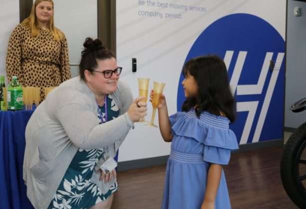 """A teacher and her student celebrate with a """"cheers!"""""""