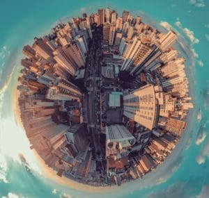 An aerial video of a city scape in a circle