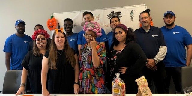 Group photo of Atlanta employees dressed up for Halloween