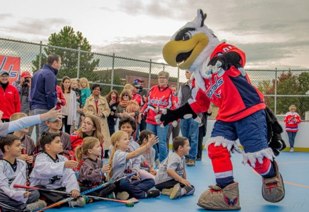 Slapshot, the Washington Capital's mascot, gives high five to kids at Dixon Park