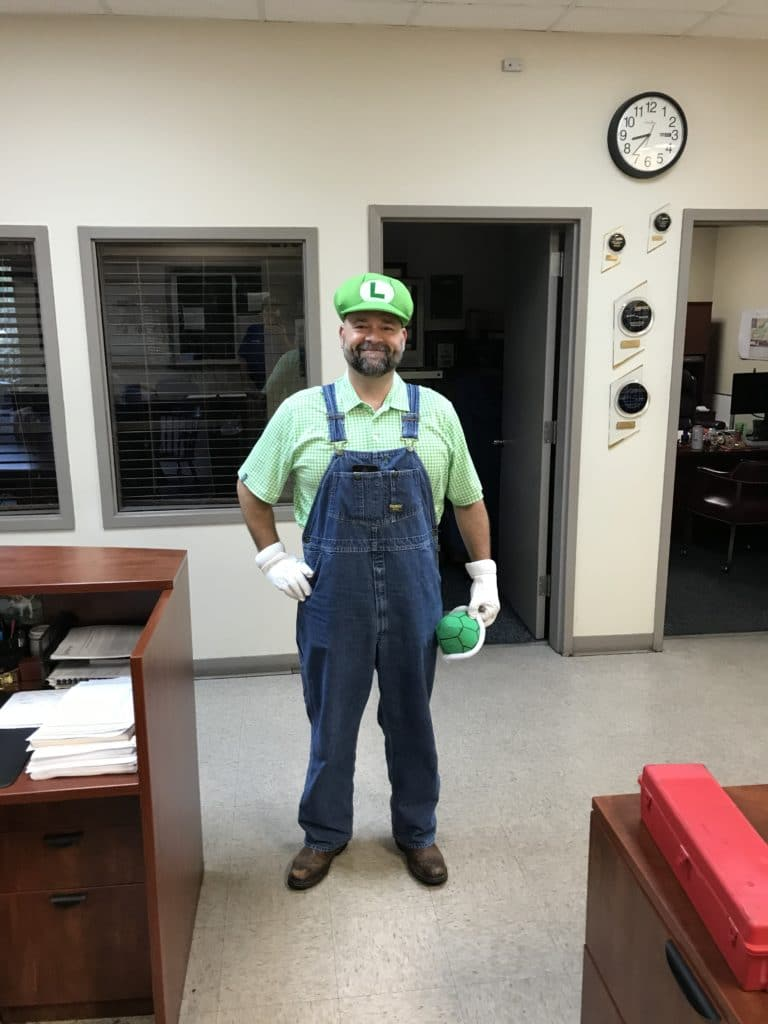 Jeremy Williams in our Raleigh office dressed as Luigi for Halloween 2019