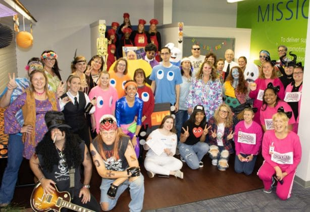 group photo of Stafford employees dressed up during 2019 Halloween