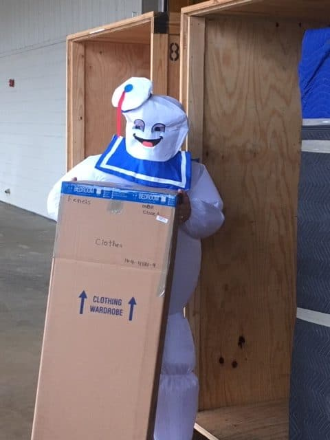 Tom Hinkley dressed up as Ghostbusters for Halloween as he helps load a vault