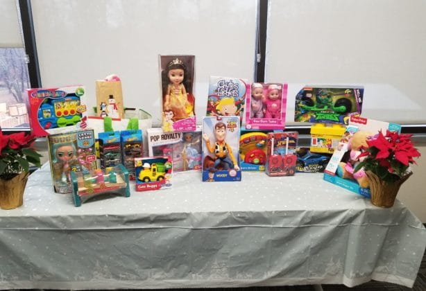 Donated children's toys are assembled on a table