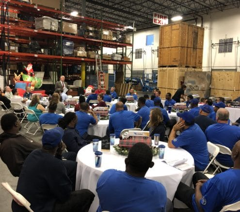 A crew meeting in a warehouse