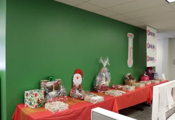 Table filled with the Christmas baskets for the raffle event