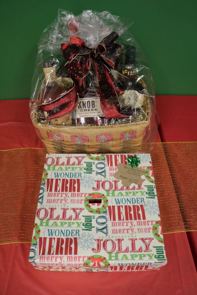 Basket with whiskey bottles and decorated for Christmas