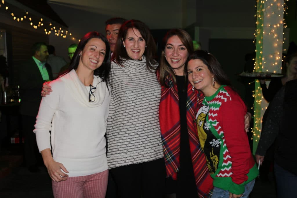 Christy, Stephanie, Tatiana and Heather of our Relocation Dept gather for a photo together during the Christmas party.