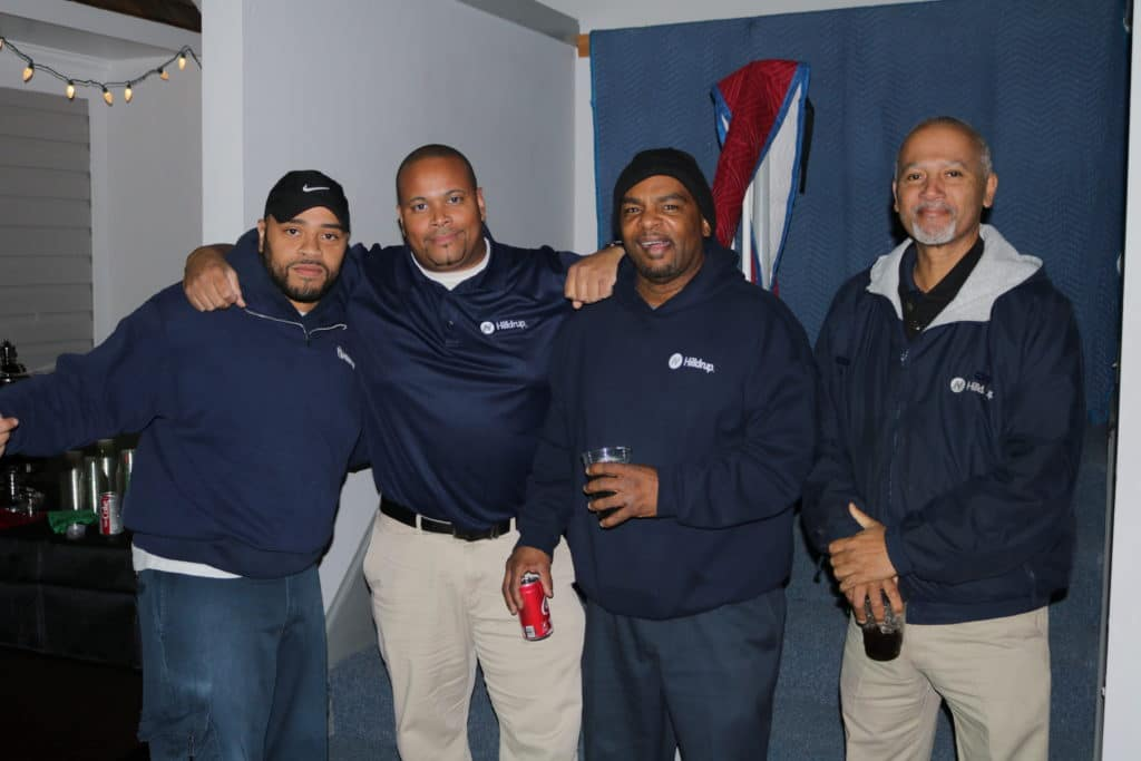 Sid, Caesar, James and Darrell of our Operations team gather for a photo during Hilldrup's Christmas party.
