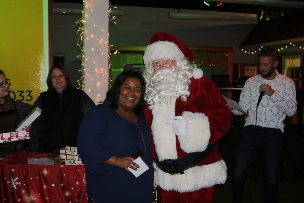 Joyce Callahan takes a photo with Santa during the Christmas party after winning a prize!