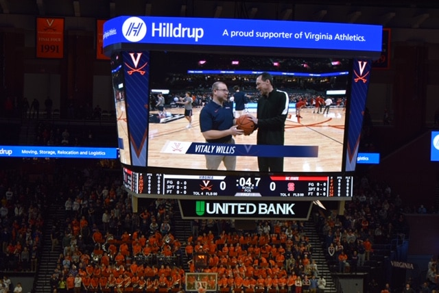 Vitaly Willis presents the game ball at the UVA vs. NC State game.