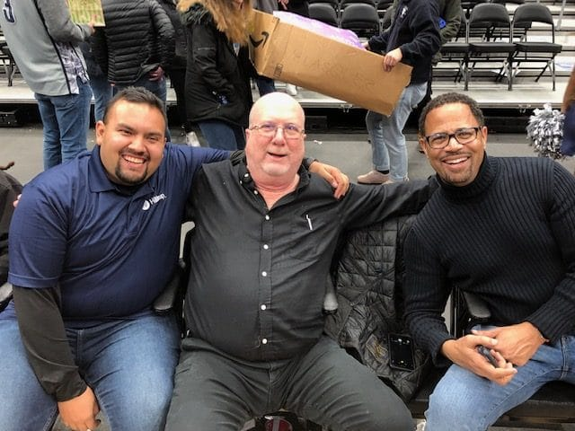 Marvin, Kevin and Remus of Hilldrup attend the Georgetown basketball game at Capital One Arena.