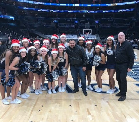Hilldrup took a photo with the Georgetown cheerleading team on the court after the game.