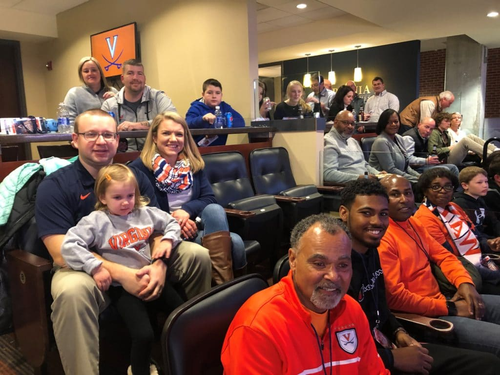 Team Hilldrup sits at the UVA game with our families.