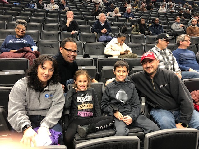Lidia and her family sit together during the Georgetown game.