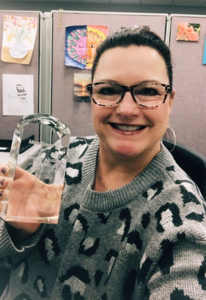 Jenny Craig holds her Heart of Quality Award