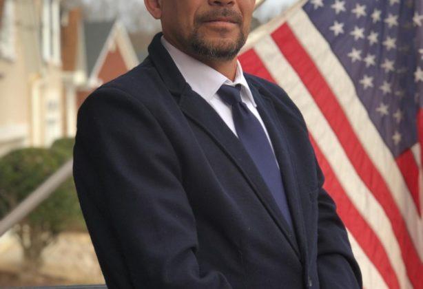 Eric Galioto, Van Operator for Hilldrup, standing on balcony.