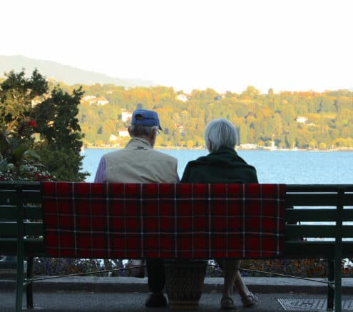 Older Couple looking at view of trees and water
