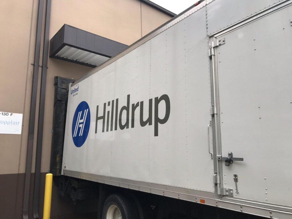 Hilldrup truck unloading food donations at a school in Georgia.