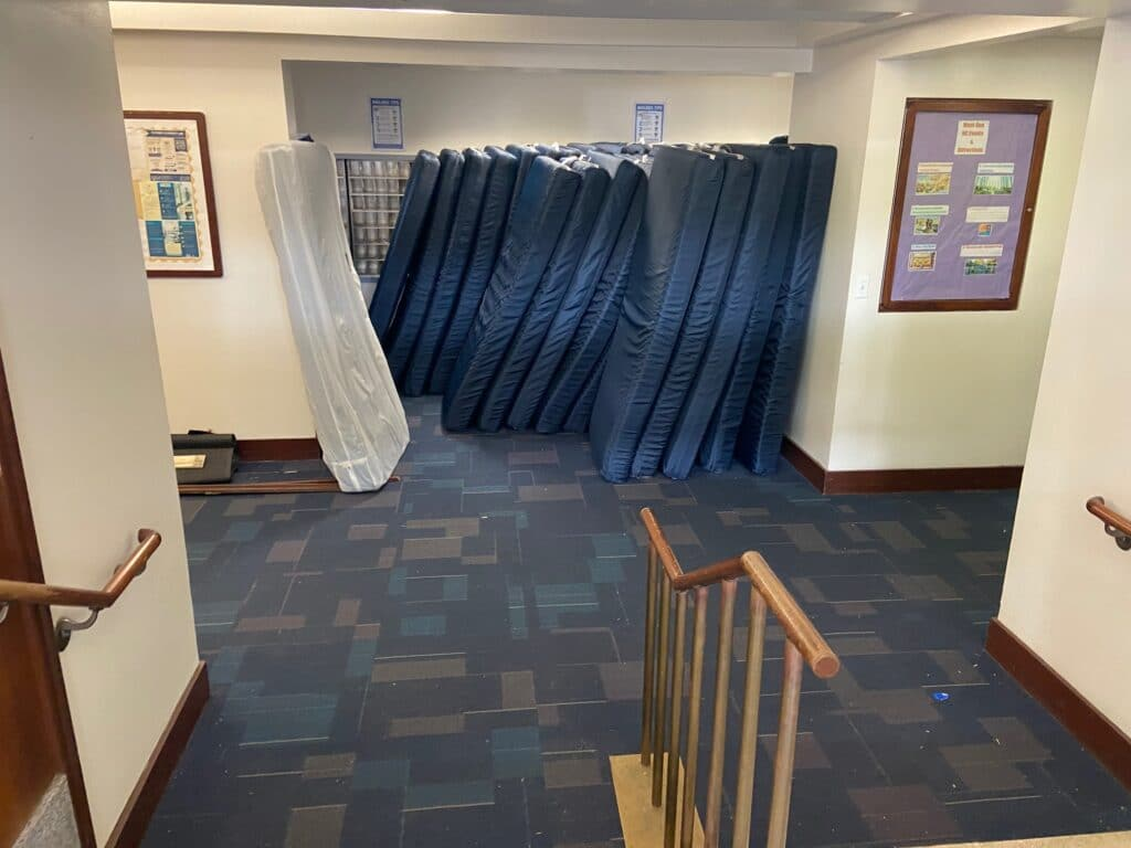Mattresses in Thurston Hall at GWU's campus are gathered for loading.