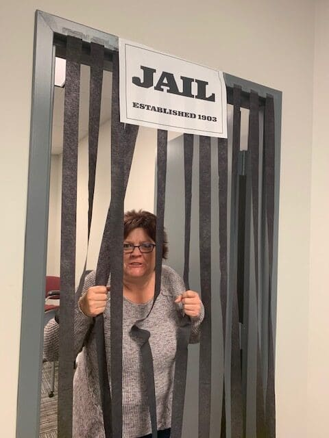 "Crystal Brinson participates in ""Hilldrup Jail"" at the office in the spirit of a RUW activity."