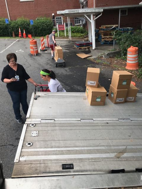 Volunteers helping with the food delivery with Move For Hunger