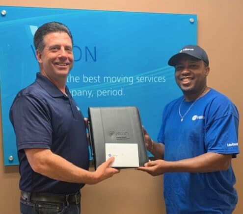Chris Scheier gives Van Operator Rico Acker a giveaway during Van Operator Appreciation Week.