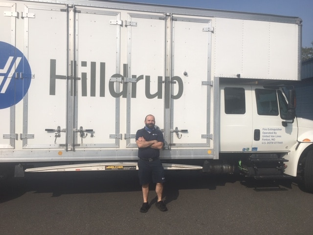 William Johnson by one of Hilldrup's trucks.