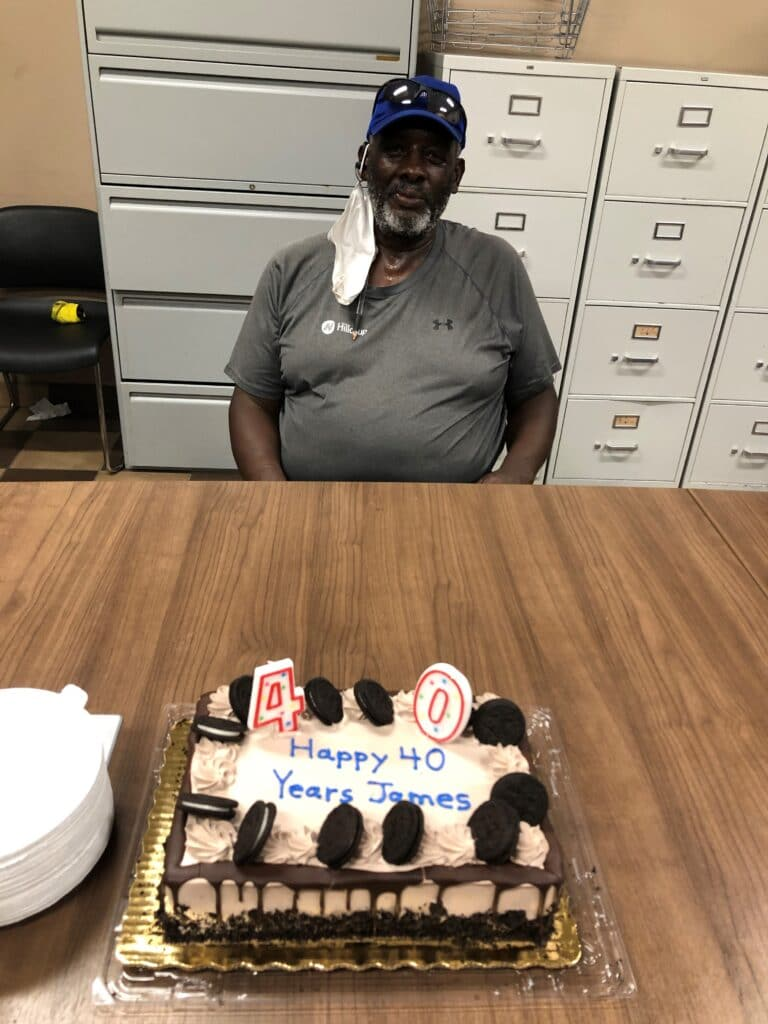 James Lewis enjoys a celebration of honoring his 40 years of service to Hilldrup at Orlando's office.