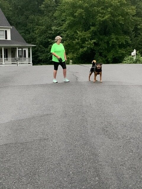 Linda Rivera and her dog participate in the Stafford Hospital 5K from her neighborhood during COVID.
