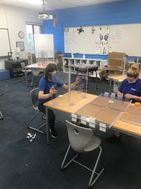 Hilldrup's Charlotte team helps install shields in classrooms amidst COVID.