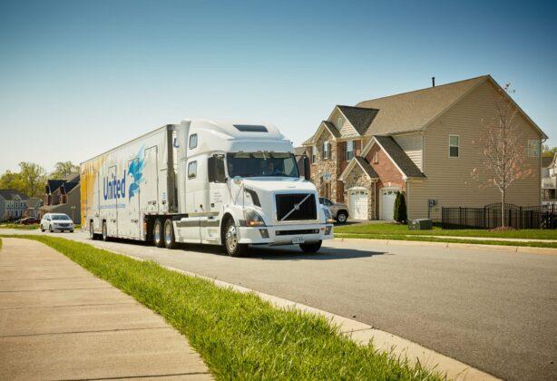 Hilldrup truck driving through a neighborhood.
