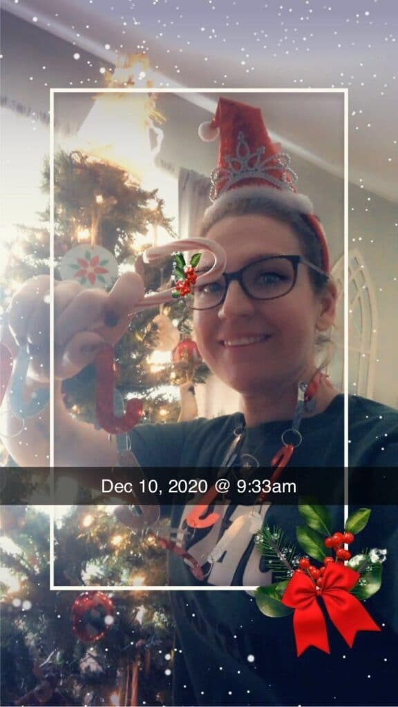 Jessica Facciolo takes a selfie with her Christmas tree for a festive virtual game.