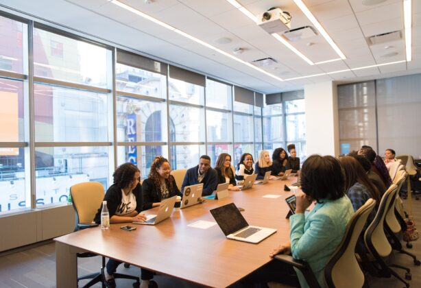 Diverse group of employees sitting at a conference table.