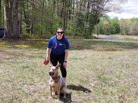 Bridget and her dog participating in the Stafford 5K