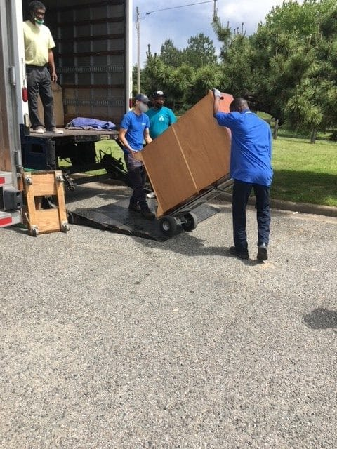 Hilldrup Richmond loads donated furniture into our truck.
