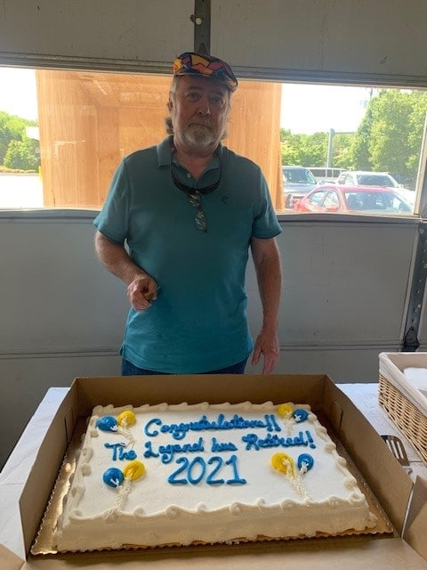 Ron Lewis enjoying his retirement cake at his retirement party.