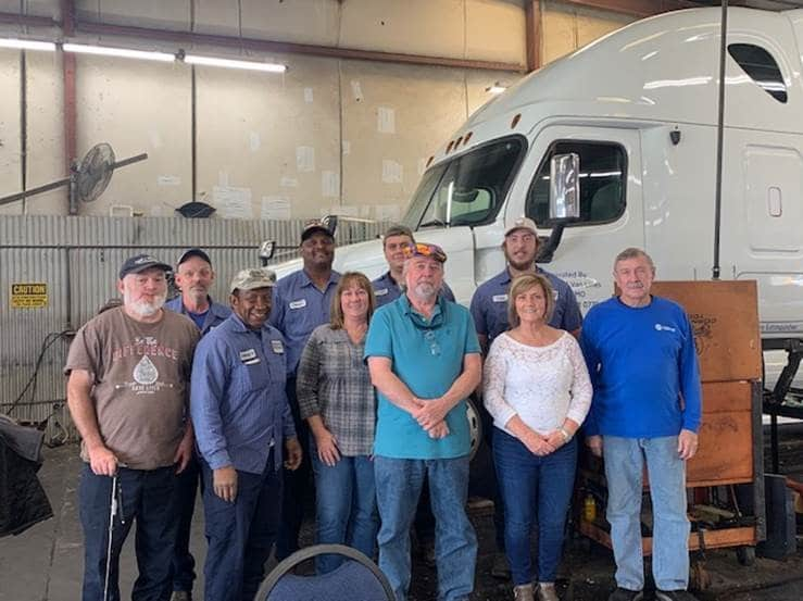 Hilldrup's Shop team joins Ron Lewis for a photo during his retirement celebration.