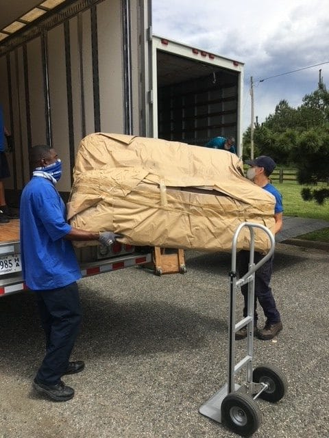 Hilldrup Richmond loads a donated couch to our trucks.