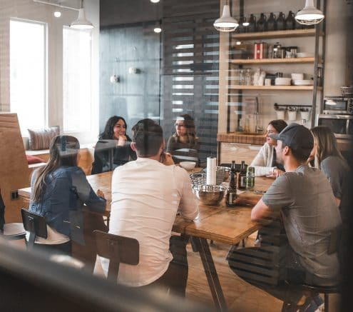 Young workers having a meeting in an open office space.