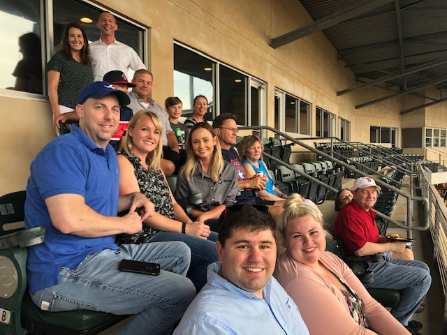 Hilldrup and friends enjoy a baseball game in Greenville together.