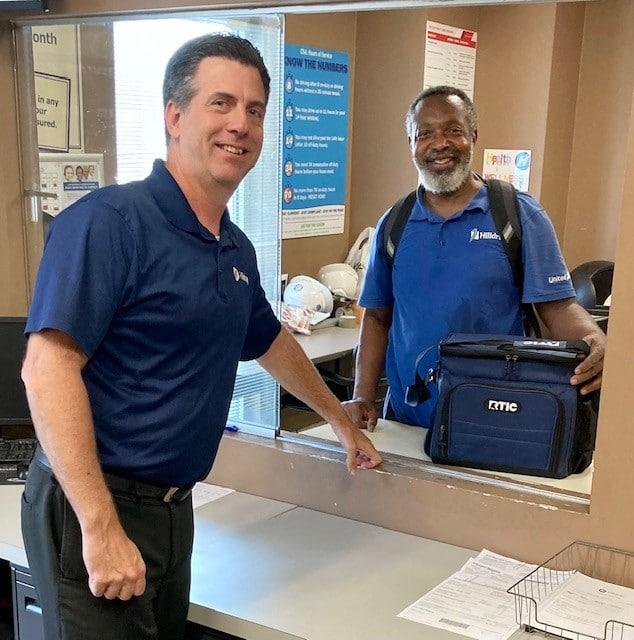 Chris Scheier and Anthony Anderson during Van Operator Appreciation Week
