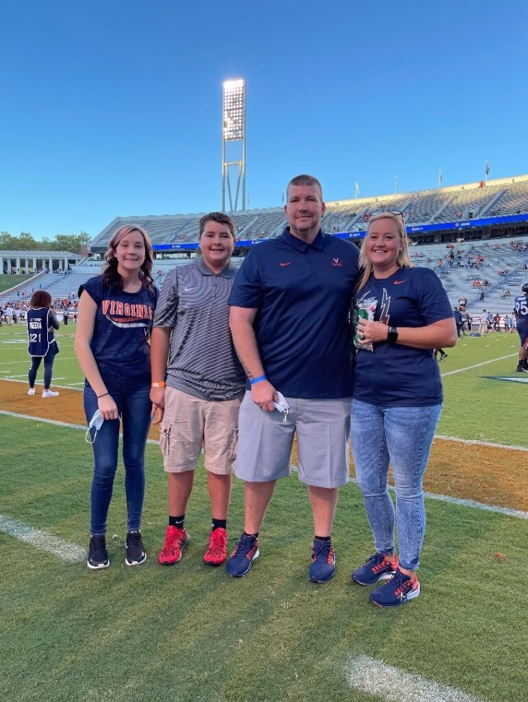 John Kibbe and his family at the UVA game.